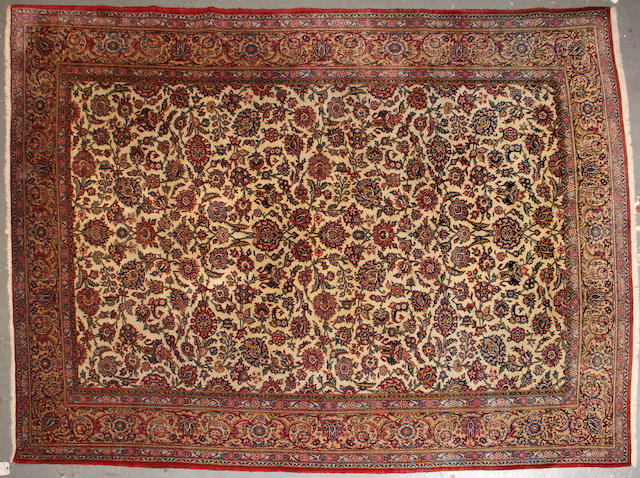 A Kashan carpet  size approximately 7ft. 1in. x 9ft. 7in.