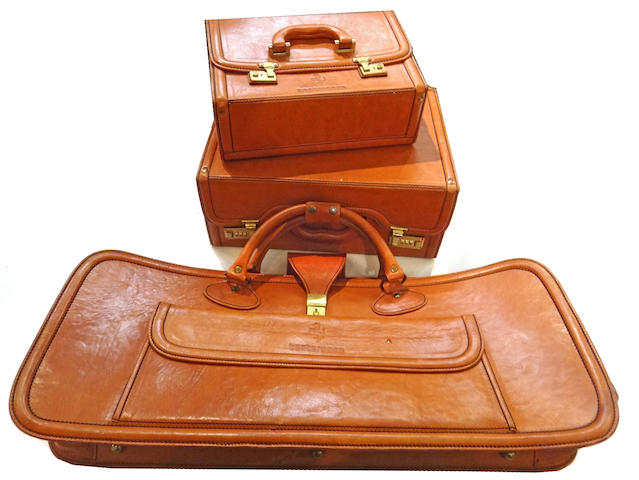 A 3 piece Ferrari Testarossa luggage set by Schedoni Leather, Modena,