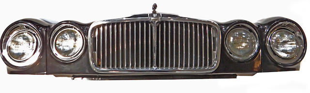 A Jaguar front end grille wall display.
