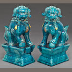 A pair of turquois blue glazed ceramic lion dogs 19th century