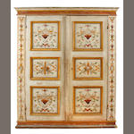 An Italian Baroque style paint decorated cupboard
