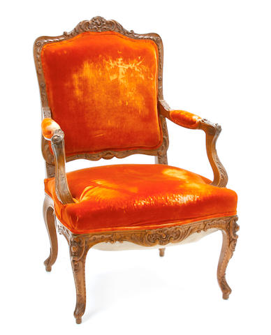 A Louis XV style carved walnut fauteuil