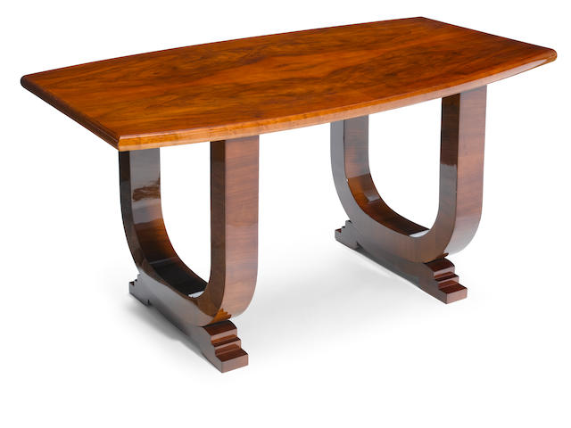 A French Art Deco mixed wood dining table, circa 1930