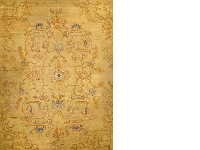 An Oushak carpet  West Anatolia size approximately 12ft. 8in. x 17ft.