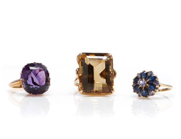 A collection of three gem-set and gold rings