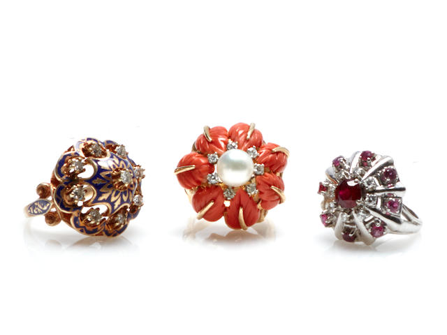 A collection of three diamond, ruby, carved coral, enamel and 14k gold rings