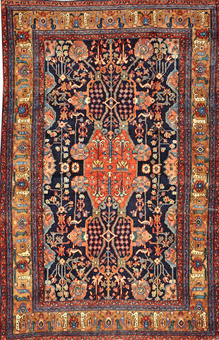 A Malayer rug  Central Persia size approximately 4ft. 4in. x 6ft. 7in.