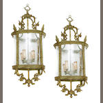 A pair of Renaissance style bronze and glass lanterns