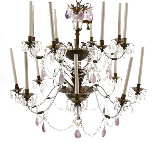 A Rococo style tole, rock crystal, and glass sixteen light chandelier