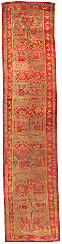 An Oushak runner West Anatolia size approximately 3ft. 3in. x 14ft. 6in.