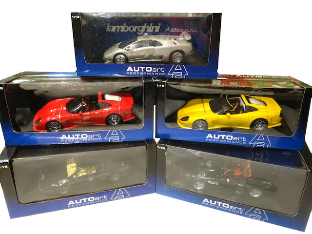 An assembled grouping of 1:18 scale Auto Art display models,
