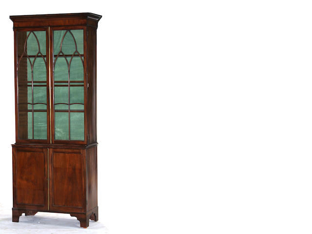 A Regency brass mounted mahogany bookcase cabinet early 19th century