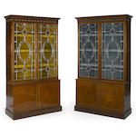 A pair of George III silvered and gilt brass mounted mahogany bookcase cabinets