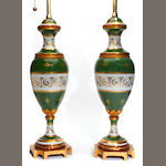 A pair of French gilt metal mounted porcelain urns, now as table lamps