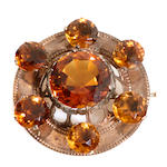 A citrine, 9k gold and metal circular brooch