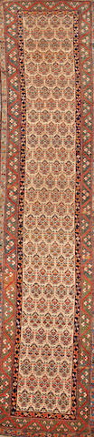 A Kurdish runner Northwest Persia size approximately 2ft. 11in. x 14ft.