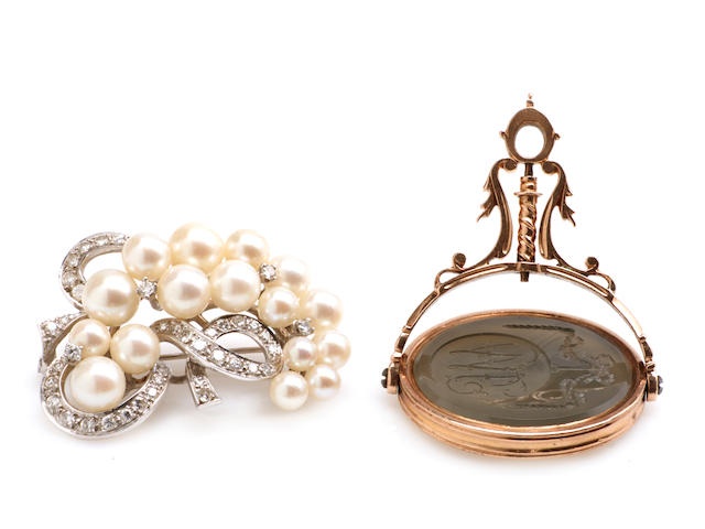 A diamond, cultured pearl and white gold brooch together with a quartz and gold intaglio fob seal