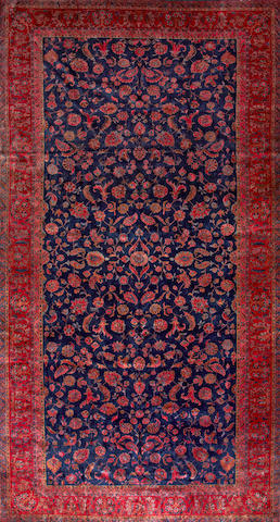 A Manchester Kashan carpet Central Persia size approximately 10ft. 2in. x 18ft. 10in.