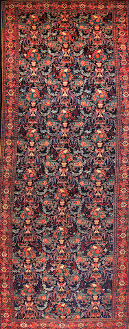 A Senneh long carpet  Central Persia size approximately 8ft. x 20ft. 1in.