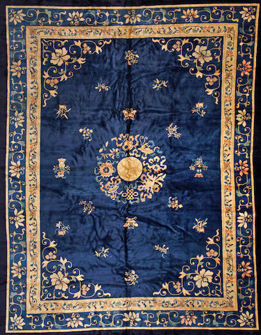 A Chinese carpet China  size approximately 9ft. x 11ft. 5in.