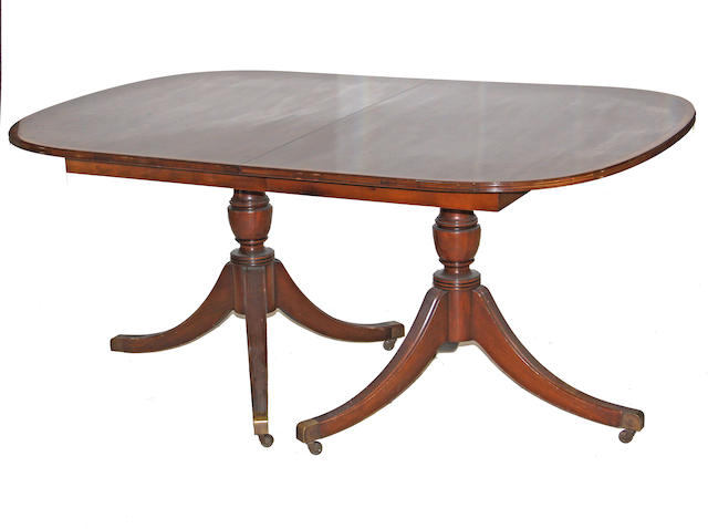 A Regency style pedestal dining room table