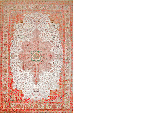 A Turkish silk carpet  Turkey size approximately 11ft. 10in. x 18ft. 5in.