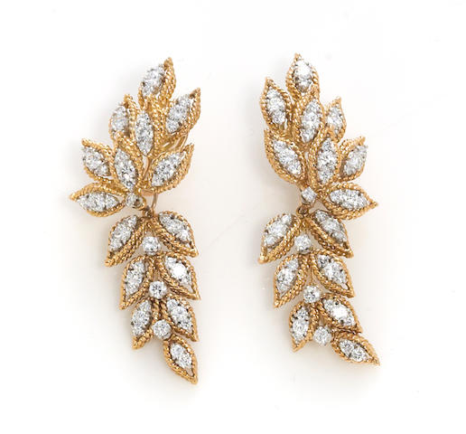 A pair of diamond foliate motif day/night earrings