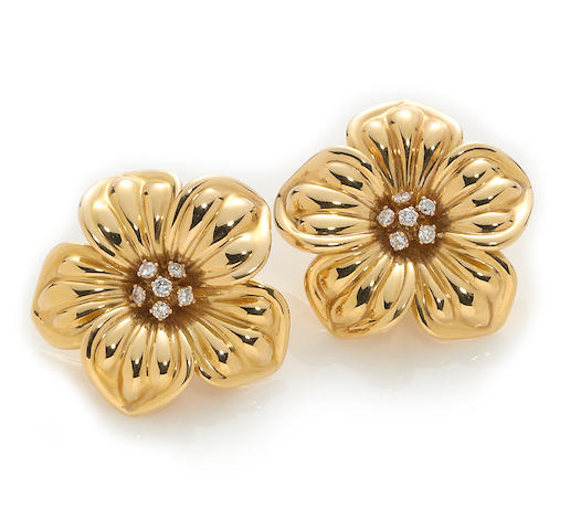 A pair of diamond and eighteen karat gold flower earclips, Van Cleef & Arpels