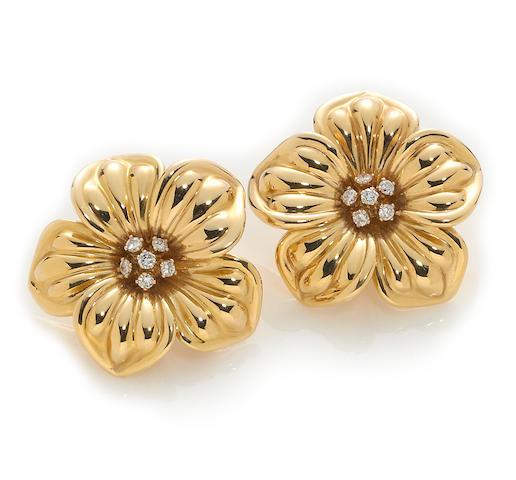 A pair of diamond and eighteen karat gold flower earclips, Van Cleef & Arpels