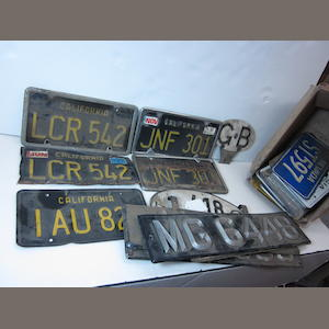 A collection of various license plates some foreign,