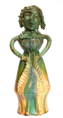 A glazed earthenware figural vessel and sculpture