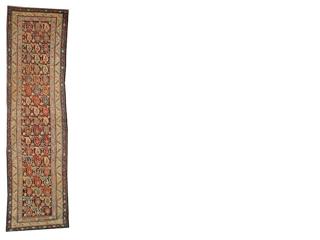 A Kurdish runner  Northwest Persia size approximately 3ft. 2in. x 11ft. 8in.