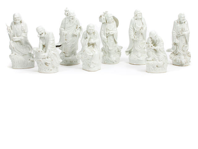 A group of eighteen glazed earthenware figures