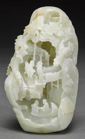 A carved white jade boulder