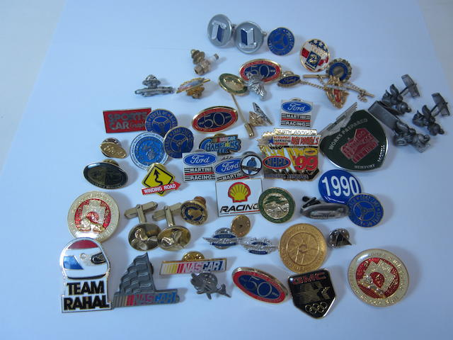 A collection of mixed auto related pins and badges,