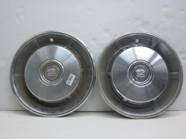 A set of Cadillac Fleetwood hubcaps,