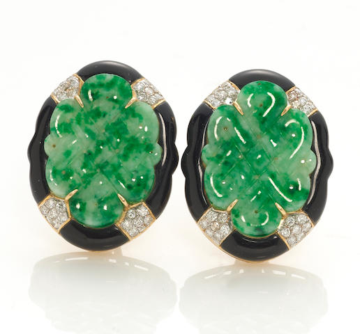 A pair of carved jade, black onyx and diamond earrings