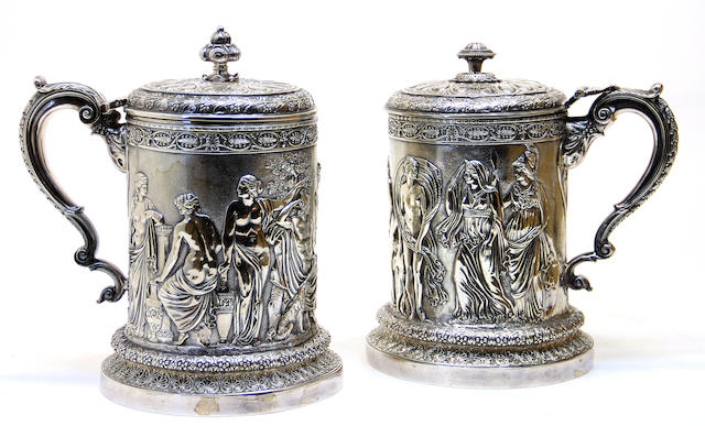 A plated assembled pair of large tankards in the neoclassical taste by Elkington & Co. and after