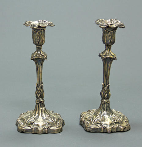 An Edward VII silver pair of weighted antique reproduction candlesticks Williams, Birmingham, 1906