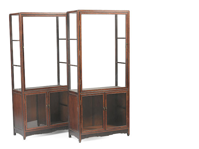 A pair of mixed wood and glass display cabinets Republic period