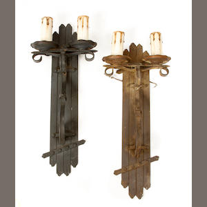 A set of six Arts and Crafts patinated metal wall lights