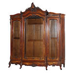 A Louis XV style carved walnut display cabinet