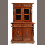 A Flemish Baroque style carved walnut cabinet