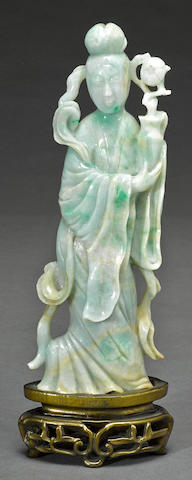 A carved jadeite figure of a beauty