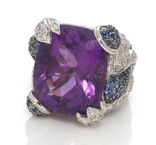An amethyst, sapphire and diamond ring