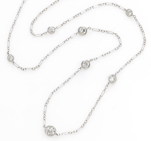 A pair of diamond and platinum long chain