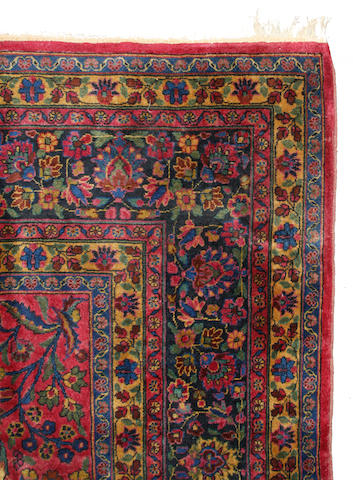A Persian carpet size approximately 9ft. 8in x 13ft. 9in