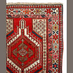 A Northwest Persian runner  size approximately 3ft. 4in. x 11ft. 11in.