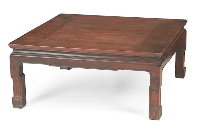 A square-sectioned hardwood low table