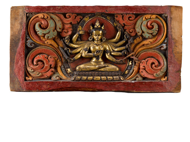 A gilt, lacquer and polychrome panel with a goddess  Tibet, circa 12th Century